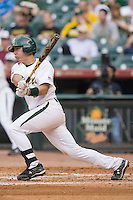 Shaver Hansen #8 of the Baylor Bears follows through on his swing versus the Houston Cougars in the 2009 Houston College Classic at Minute Maid Park February 27, 2009 in Houston, TX.  The Bears defeated the Cougars 3-2. (Photo by Brian Westerholt / Four Seam Images)
