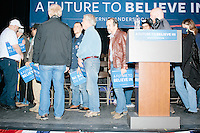 People gather on stage after Vermont senator and Democratic presidential candidate Bernie Sanders spoke at a town hall at the Rochester Opera House in Rochester, New Hampshire, on Thurs., Feb. 4, 2016. Press and attendee turnout was low for the event because of scheduling issues. The rally had been scheduled for the previous day, postponed, and then rescheduled just a few hours before the event took place. Later that night, Sanders took part in an MSNBC-sponsored debate with Hillary Rodham Clinton.
