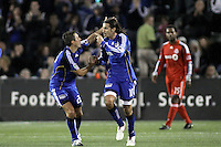 Davy Arnaud (left) and Santiago Hirsig (right) celebrate Arnaud's second goal. Toronto FC defeated Kansas City Wizards 3-2 at Community America Ballpark, Kansas City, Kansas. March 21, 2009.