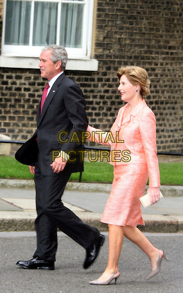 PRESIDENT GEORGE W. BUSH & FIRST LADY LAURA BUSH.President Bush and his wife Laura visit the Prime Minister Gordon Brown and his wife Sarah Brown for an informal dinner on Bush's farewell tour, 10 Downing Street, London, England, .15th June 2008.full length black suit peach skirt jacket side profile walking married husband wife .CAP/DS.©Dudley Smith/Capital Pictures