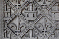 Detail of low reliefs depicting Fleur de lys and Castilian castles on the base of the portal of the lower chapel, La Sainte-Chapelle (The Holy Chapel), 1248, Paris, France.  Fleur de lys and Castilian castles symbolize Saint Louis and his mother, Blanche de Castille. La Sainte-Chapelle was commissioned by King Louis IX of France to house his collection of Passion Relics, including the Crown of Thorns. It is considered among the highest achievements of the Rayonnant period of Gothic architecture. Picture by Manuel Cohen