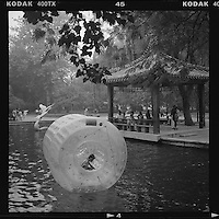 A Chinese boy plays inside an inflatable at a park in Beijing, China, July 2012. (Mamiya 6, 75mm, Kodak TRI-X film)