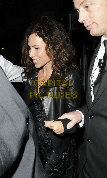 MINNIE DRIVER.The Mahiki & Gallo Rose pop-up launch party, the House of St. Barnabus, London, England..May 20th, 2010.half length black lace dress leather jacket minder bodyguard.CAP/CAN.©Can Nguyen/Capital Pictures.