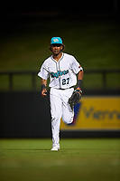 Salt River Rafters right fielder Jerar Encarnacion (27), of the Miami Marlins organization, jogs off the field between innings of an Arizona Fall League game against the Mesa Solar Sox on September 19, 2019 at Salt River Fields at Talking Stick in Scottsdale, Arizona. Salt River defeated Mesa 4-1. (Zachary Lucy/Four Seam Images)