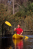 Single male kayaking on lak