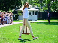First lady Melania Trump walks on the South Lawn of the <br /> White House in Washington, DC to join United States President Donald J. Trump after he made remarks and answered reporter's questions as he prepares to depart on Friday, July 5, 2019.  The President will travel to Westminster, New Jersey for the weekend. Photo Credit: Ron Sachs/CNP/AdMedia