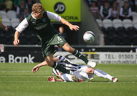 David Barron tackles David Wotherspoon in the St Mirren v Hibernian Clydesdale Bank Scottish Premier League match played at St Mirren Park, Paisley on 18.8.12.