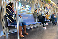 MAR 24 New Yorkers Practice Social Distancing in NYC Subway Train