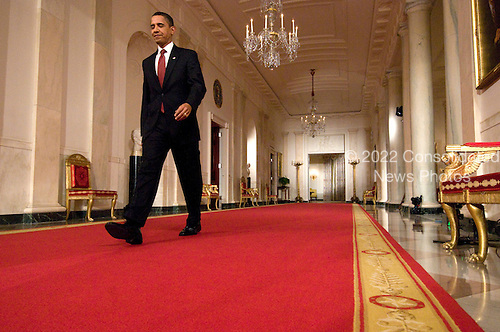Washington, DC - February 9, 2009 -- United States President Barack Obama walks through the Cross Hall on his way to conduct his first formal press conference in the East Room of the White House in Washington, D.C. on Monday, February 9, 2009..Credit: Ron Sachs / CNP..(RESTRICTION: No New York Metro or other Newspapers within a 75 mile radius of New York City)