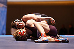 CLEVELAND, OH - MARCH 10: Sam Bennyhoff, of Augsburg wrestles Brock Rathbun, of Wartburg, in the 133 weight class during the Division III Men's Wrestling Championship held at the Cleveland Public Auditorium on March 10, 2018 in Cleveland, Ohio. Rathbun went on to place first in the 133 weight class.  (Photo by Jay LaPrete/NCAA Photos via Getty Images)