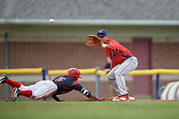 Williamsport Crosscutters first baseman Nerluis Martinez (11) as Samuel Castro (5) dives back to the bag waits to receive a throw during a game against the Batavia Muckdogs on August 3, 2017 at Dwyer Stadium in Batavia, New York.  Williamsport defeated Batavia 2-1.  (Mike Janes/Four Seam Images)
