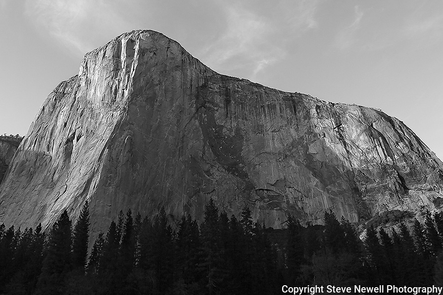 """Capitan's Glory"" Black and White El Capitan, Yosemite NP. El Capitan is one of the most spectacular granite monoliths in the world.  Climbers from around the world flock to Yosemite Valley every year for a chance to climb this grand spectacle.  The most famous climbing route on El Capitan is ""The Nose"".  The route ascends the prow on the sun/shade line to the right of the Heart.  The prominent Heart appears as if was carved into the rock but is a natural formation on El Capitan."
