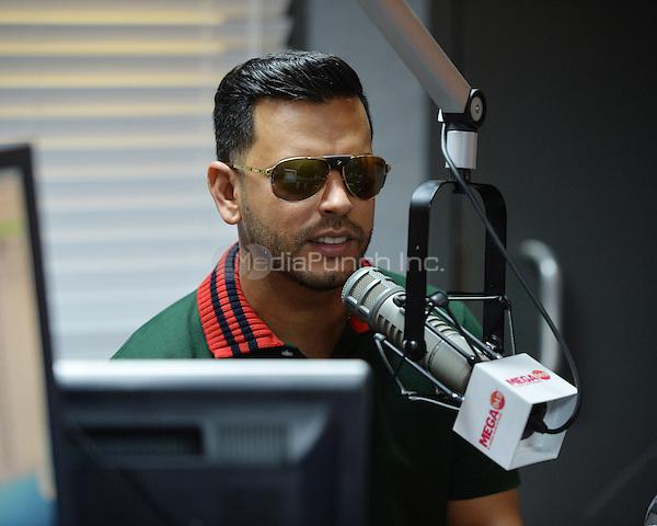 FORT LAUDERDALE, FL - MAY 12: Tito El Bambino visits Radio Station MEGA 94.9 on May 12, 2016 in Fort Lauderdale, Florida. Credit: mpi04/MediaPunch