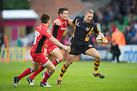 130712 Copyright onEdition 2012 ©.Free for editorial use image, please credit: onEdition..Danny Wells of London Wasps forces his way past Nils Mordt of Saracens at The Stoop, Twickenham in the first round of The J.P. Morgan Asset Management Premiership Rugby 7s Series...The J.P. Morgan Asset Management Premiership Rugby 7s Series kicked off again for the third season on Friday 13th July at The Stoop, Twickenham with Pool B being played at Edgeley Park, Stockport on Friday, 20th July, Pool C at Kingsholm Gloucester on Thursday, 26th July and the Final being played at The Recreation Ground, Bath on Friday 3rd August. The innovative tournament, which involves all 12 Premiership Rugby clubs, offers a fantastic platform for some of the country's finest young athletes to be exposed to the excitement, pressures and skills required to compete at an elite level...The 12 Premiership Rugby clubs are divided into three groups for the tournament, with the winner and runner up of each regional event going through to the Final. There are six games each evening, with each match consisting of two 7 minute halves with a 2 minute break at half time...For additional images please go to: http://www.w-w-i.com/jp_morgan_premiership_sevens/..For press contacts contact: Beth Begg at brandRapport on D: +44 (0)20 7932 5813 M: +44 (0)7900 88231 E: BBegg@brand-rapport.com..If you require a higher resolution image or you have any other onEdition photographic enquiries, please contact onEdition on 0845 900 2 900 or email info@onEdition.com.This image is copyright the onEdition 2012©..This image has been supplied by onEdition and must be credited onEdition. The author is asserting his full Moral rights in relation to the publication of this image. Rights for onward transmission of any image or file is not granted or implied. Changing or deleting Copyright information is illegal as specified in the Copyright, Design and Patents Act 1988. If you are in any way unsure of your right to publish this im