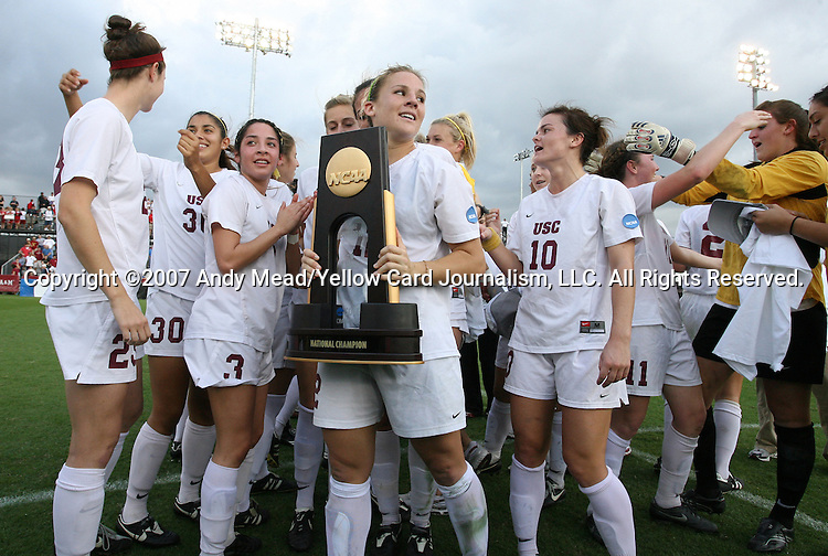 09 December 2007: USC's Amy Rodriguez (center) holds the championship trophy as the team celebrates after the game. The University of Southern California Trojans won the 2008 NCAA Division I Women's College Cup championship game at the Aggie Soccer Stadium in College Station, Texas.