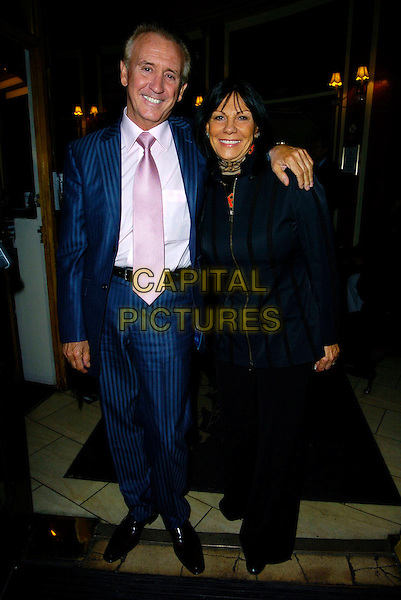 "TONY CHRISTIE & GUEST.""Guys & Dolls"" VIP Performance, Picadilly Theatre, London, UK..January 24th, 2007.full length blue pinstripe suit arm over shoulder top black trousers.CAP/CAN.©Can Nguyen/Capital Pictures"