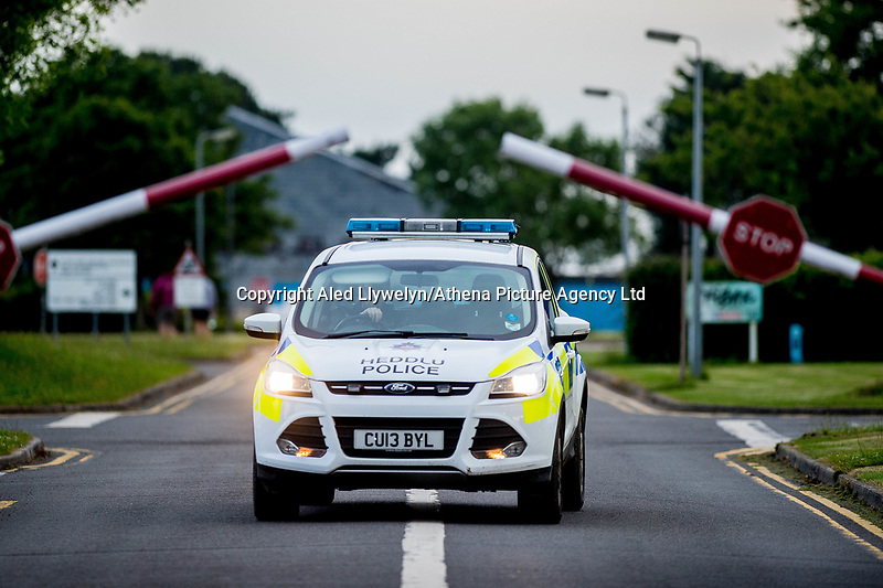 """Wednesday 14 June 2017<br /> Pictured: Police at the entrance to the firing range <br /> Re: Paramedics and a fire crews are in attendance at what has been describes as an """"ongoing incident"""" at a military training base in Pembrokeshire.<br /> The Welsh Ambulance Service said it was alerted to an incident at the Castlemartin firing range just before 15:30 BST on Wednesday.<br /> The range is owned by the Ministry of Defence (MOD) Live firing was due to take place at the range from Monday to Friday.<br /> Mid and West Wales Fire and Rescue Service is also in attendance.<br /> Castlemartin is the only UK Army range normally available for direct-fire live gunnery exercises and is used by Army, Army reserves and cadets.<br /> It is also used by civilian organisations and research establishments."""