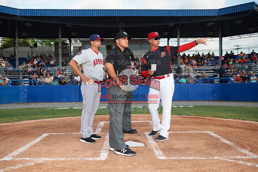Batavia Muckdogs manager Mike Jacobs (28) goes over the ground rules with umpires Dexter Kelley (back), Kelvis Velez (front), and manager Jerad Head (left) during the lineup exchange before a game against the Auburn Doubledays on June 19, 2017 at Dwyer Stadium in Batavia, New York.  Batavia defeated Auburn 8-2 in both teams opening game of the season.  (Mike Janes/Four Seam Images)