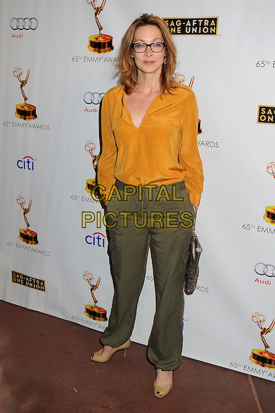Sharon Lawrence<br /> Academy of Television Arts &amp; Sciences' Dynamic and Diverse 2013 Emmy Nominee Reception, North Hollywood, California, USA.<br /> September 17th, 2013<br /> full length yellow blouse green trousers glasses <br /> CAP/ADM/BP<br /> &copy;Byron Purvis/AdMedia/Capital Pictures