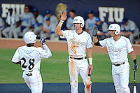 5 May 2012:  FIU outfielder Jabari Henry (14) celebrates his fourth inning two-run home run with outfielder Nathan Burns (6, center) and infielder/outfielder Tyler James Shantz (5, right) as the FIU Golden Panthers defeated the Middle Tennessee State University Blue Raiders, 12-6, at University Park Stadium in Miami, Florida.