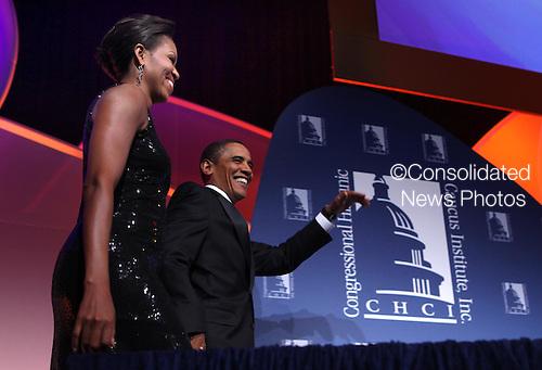 Washington, DC - September 16, 2009 -- United States President Barack Obama and First Lady Michelle Obama at the Congressional Hispanic Caucus Institute (CHCI) dinner in Washington DC on September 16, 2009. .Credit: Dennis Brack - Pool via CNP