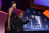 Washington, DC - September 16, 2009 -- United States President Barack Obama and First Lady Michelle Obama at the Congressional Hispanic Caucus Institute (CHCI) dinner in Washington DC on September 16, 2009. .Credit: Dennis Brack - Pool via CNP