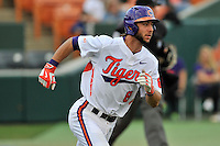 Second baseman Weston Wilson (8) of the Clemson University Tigers runs out a ball in a game against the Wofford College Terriers on Tuesday, March 1, 2016, at Doug Kingsmore Stadium in Clemson, South Carolina. Clemson won, 7-0. (Tom Priddy/Four Seam Images)
