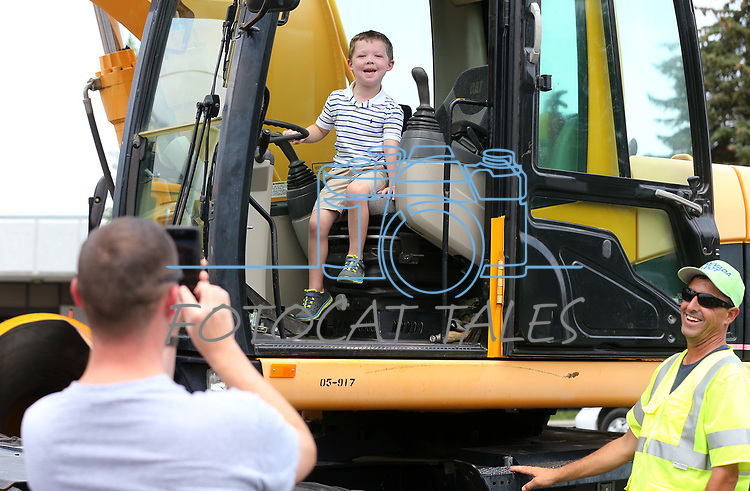 Walker Odom, 3, poses for a photo with Nevada Department of Transportation heavy equipment during the Touch-a-Truck event at the Carson City Library in Carson City, Nev., on Saturday, Aug. 5, 2017. <br /> Photo by Cathleen Allison/Nevada Photo Source
