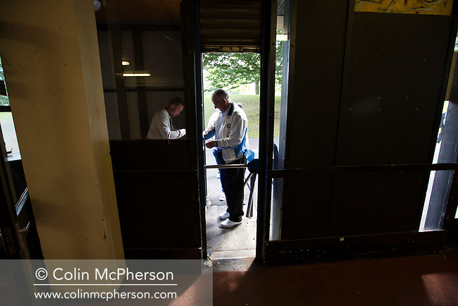 A spectator paying in at a turnstile under the grandstand at Meadowbank Stadium prior to Edinburgh City's fixture against Berwick Rangers. Despite taking the lead in the 66th minute through Ousman See's goal, City lost the game 2-1, watched by a crowd of 410 and remained without a point at the foot of the table after four League games.