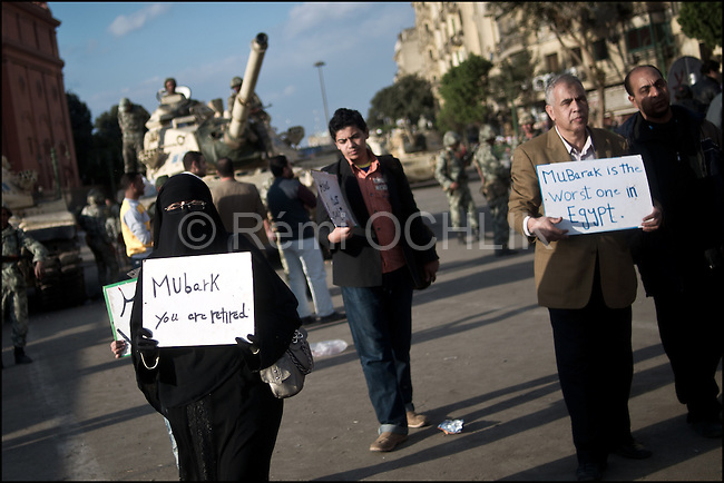 "© Remi OCHLIK/IP3 - Cairo Jan. 31 --  In front of the tanks, a anti mubarak protester hold a sign on which can be read  "" Mubarak you are retired "".Tens of thousands of people in Egypt are taking part in a seventh day of protests calling for the country's leader to step down. Crowds have been growing in Cairo's Tahrir Square and in other cities, with many shouting slogans and waving placards calling for Hosni Mubarak's downfall. Far greater numbers are expected to hit the streets tomorrow for a mass rally billed as the ""protest of the millions"".There have been some reports of 25,000 people in Tahrir Square but the realistic estimate is between 10,000 and 15,000."