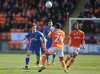 Peterborough United's Alex Woodyard vies for possession with Blackpool's Liam Feeney<br /> <br /> Photographer Kevin Barnes/CameraSport<br /> <br /> The EFL Sky Bet League One - Blackpool v Peterborough United - Saturday 13th April 2019 - Bloomfield Road - Blackpool<br /> <br /> World Copyright &copy; 2019 CameraSport. All rights reserved. 43 Linden Ave. Countesthorpe. Leicester. England. LE8 5PG - Tel: +44 (0) 116 277 4147 - admin@camerasport.com - www.camerasport.com