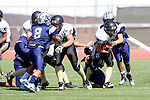 Torrance, CA 09/05/13 - Nick Orlando (Peninsula #27), Johnny Kimura (Peninsula #64) and unidentified North JV player(s) in action during the Peninsula vs North Junior Varsity football game played at North High School in Torrance, California.