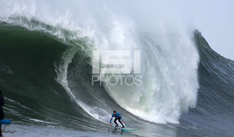 "Half Moon Bay, California - January 24, 2014: 2014 Maverick's Invitational Champion Grant ""Twiggy"" Baker with a bottom turn."