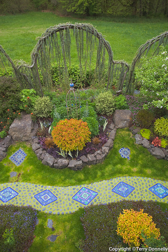 Vashon Island, WA<br /> Garden of tile artist Clare Dohna featuring moasic tile installations and a serpentine pathway