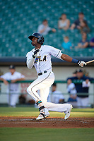 New Orleans Baby Cakes Lewis Brinson (6) hits an RBI single during a Pacific Coast League game against the Oklahoma City Dodgers on May 6, 2019 at Shrine on Airline in New Orleans, Louisiana.  New Orleans defeated Oklahoma City 4-0.  (Mike Janes/Four Seam Images)