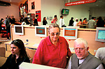 'EASYEVERYTHING INTERNET CAFE', LONDON, UK 1999. PEOPLE OF ALL AGES ARE USING THE INTERNET FOR ANYTHING FROM RESEARCH TO SHOPPING, 2000
