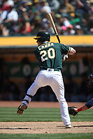 OAKLAND, CA - JUNE 30:  Mark Canha #20 of the Oakland Athletics bats against the Cleveland Indians during the game at the Oakland Coliseum on Saturday, June 30, 2018 in Oakland, California. (Photo by Brad Mangin)