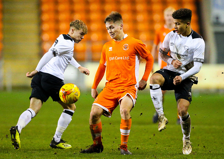 Blackpool's Will McGladdery shields the ball from Derby County's Kornell McDonald<br /> <br /> Photographer Alex Dodd/CameraSport<br /> <br /> The FA Youth Cup Third Round - Blackpool U18 v Derby County U18 - Tuesday 4th December 2018 - Bloomfield Road - Blackpool<br />  <br /> World Copyright &copy; 2018 CameraSport. All rights reserved. 43 Linden Ave. Countesthorpe. Leicester. England. LE8 5PG - Tel: +44 (0) 116 277 4147 - admin@camerasport.com - www.camerasport.com