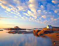 Hancock County, ME <br /> Morning light on Stonington Harbor's wharfs and fishing boats at low tide, Deer Island