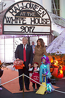 United States President Donald J. Trump and First Lady Melania Trump pose for photos while giving out treats during a Halloween event at The White House in Washington, DC, October 30, 2017. <br /> Credit: Chris Kleponis / CNP /MediaPunch /NortePhoto.com