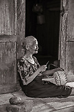 INDONESIA, Flores, portraits of an elder woman basket maker at Belaraghi village