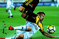 Kosta Barbarouses tackles Nathan Burns during the A-League football match between Wellington Phoenix and Melbourne Victory at Westpac Stadium in Wellington, New Zealand on Friday, 10 January 2018. Photo: Dave Lintott / lintottphoto.co.nz