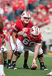 Wisconsin Badgers quarterback Jon Budmayr (5) and center Jake Current (6) during an NCAA college football game against the Austin Peay Governors on September 25, 2010 at Camp Randall Stadium in Madison, Wisconsin. The Badgers beat the Governors 70-3. (Photo by David Stluka)