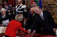 Il Ministro degli Esteri Emma Bonino stringe la mano al Presidente del Consiglio Enrico Letta, destra, affiancato dal Presidente della Repubblica Giorgio Napolitano, al centro, alla cerimonia del giuramento del nuovo governo al Quirinale, Roma, 28 aprile 2013..Italian Foreign Minister Emma Bonino shakes hands with Premier Enrico Letta, right, past Head of State Giorgio Napolitano, center, during the swearing in ceremony of the new government at the Quirinale presidential palace Rome, 28 April 2013..UPDATE IMAGES PRESS/Isabella Bonotto