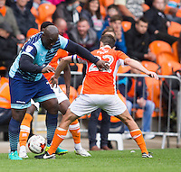 Adebayo Akinfenwa of Wycombe Wanderers battles with Danny Pugh of Blackpool during the Sky Bet League 2 match between Blackpool and Wycombe Wanderers at Bloomfield Road, Blackpool, England on 20 August 2016. Photo by James Williamson / PRiME Media Images.