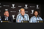 05 December 2013: Jimmy Nielsen (DEN) (center) answers a question as head coach Peter Vermes (left) and Graham Zusi (right) listen. Sporting Kansas City held a press conference at the Three Points Club in Kansas City, Missouri two days before playing Real Salt Lake in MLS Cup 2013.