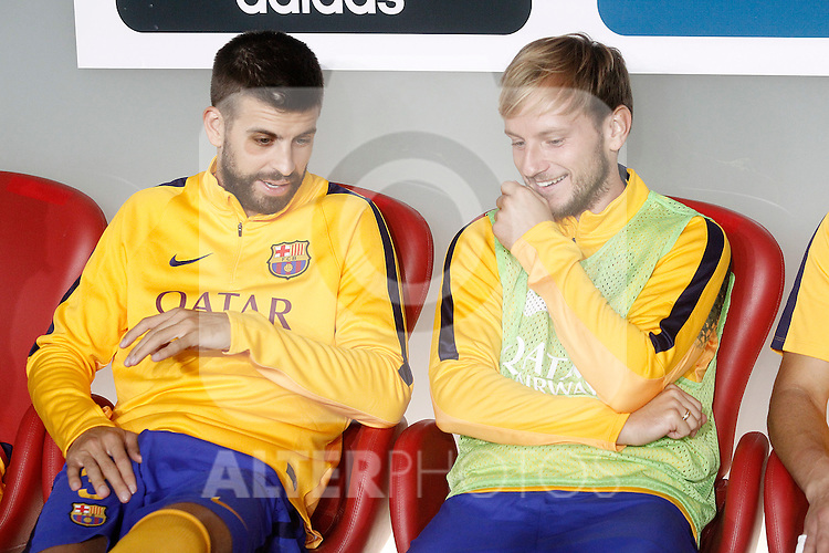 FC Barcelona's Gerard Pique (l) and Ivan Rakitic during Supercup of Spain 1st match.August 14,2015. (ALTERPHOTOS/Acero)