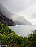 Sun rays beam upon Kalalau Beach and cliffs, Kaua'i.