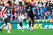 9th September 2017, bet365 Stadium, Stoke-on-Trent, England; EPL Premier League football, Stoke City versus Manchester United; Mame Biram Diouf of Stoke City chases Marcus Rashford of Manchester United