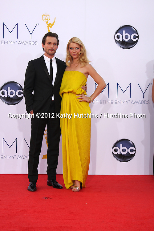 LOS ANGELES - SEP 23:  Hugh Dancy, Claire Danes arrives at the 2012 Emmy Awards at Nokia Theater on September 23, 2012 in Los Angeles, CA